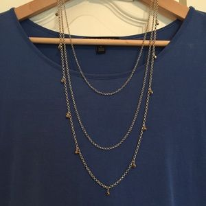Triple layered silver tone necklace. NWT